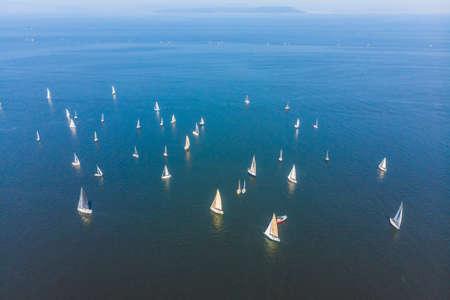 Birds eye view of beautiful purple sail boat cruising in the Aegean open sea Stock Photo