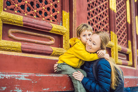 Mom and son travelers in the Temple of Heaven in Beijing. One of the main attractions of Beijing.