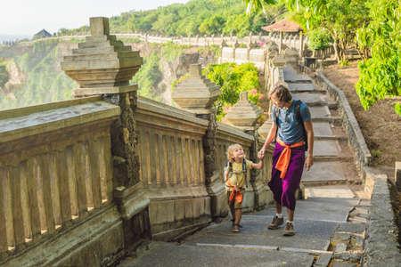 Dad and son travelers in Pura Luhur Uluwatu temple, Bali, Indonesia.