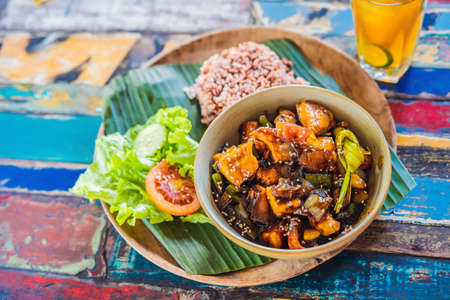 Popular Balinese meal of rice with variety of side dishes which are served together with the rice and more as optional extras