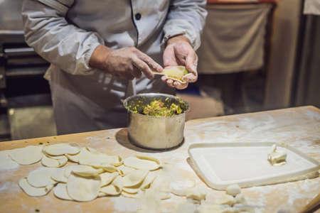 Chinese chef making dumplings in the kitchen 版權商用圖片