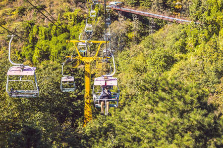 A man rides the cable car to the Great Wall of China Stock fotó - 114884600