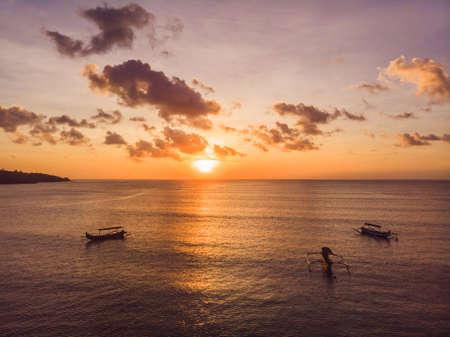 Traditional Balinese boat Jukung at Jimbaran beach at sunset in Bali, Indonesia