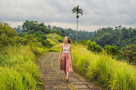 Young woman traveler in Campuhan Ridge Walk , Scenic Green Valley in Ubud Bali