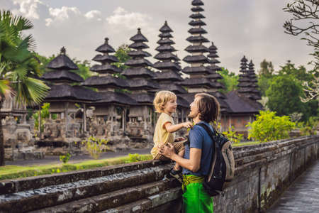 Dad and son tourists in Traditional balinese hindu Temple Taman Ayun in Mengwi.