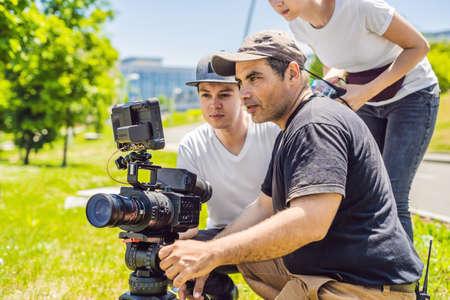 A cameraman operator discuss the shooting process with a director Foto de archivo