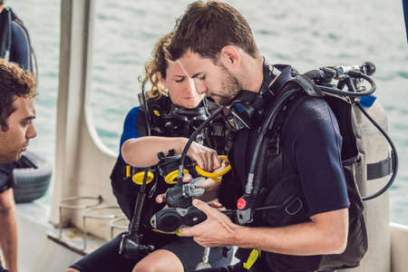 Diver prepares his equipment for diving in the sea Stock Photo