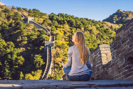 Happy cheerful joyful tourist woman at Great Wall of China meditates on vacation trip in Asia. Stock fotó