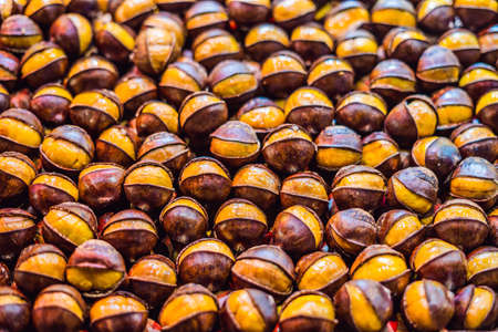 Bunch of roasted chestnuts at street wendor. Roasted Chestnuts, Street Food