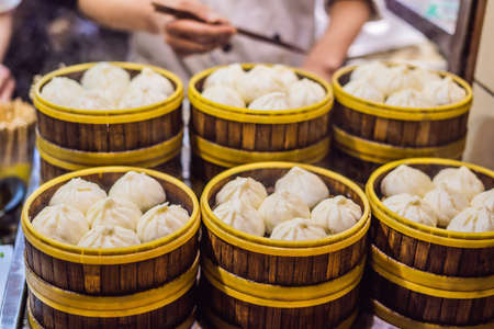 Street food booth selling Chinese specialty Steamed Dumplings in Beijing, China Stock Photo