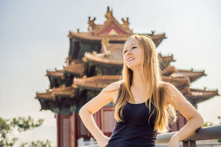 Enjoying vacation in China. Young woman in Forbidden City. Travel to China concept.