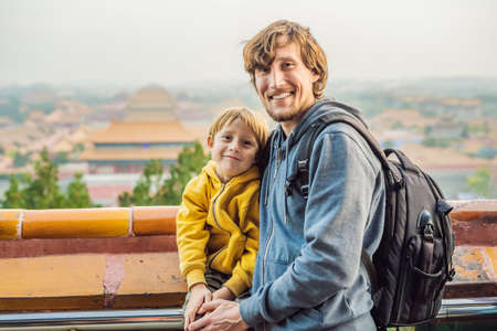 Enjoying vacation in China. Dad and son in Forbidden City. Travel to China with kids concept. Stok Fotoğraf