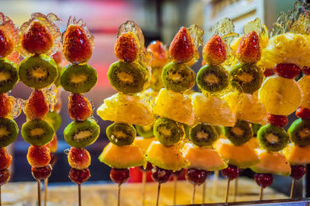 Traditional Chinese Dessert - Candied Fruit on a Wooden Stick