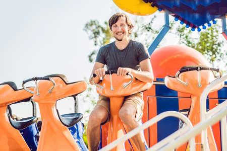 Beautiful, young man having fun at an amusement park