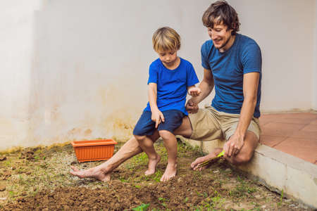 Father and son gardening in the garden near the house Stock Photo
