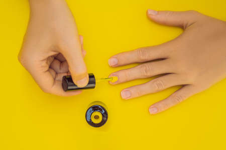 Woman Hands Care. Top View Of Beautiful Smooth Womans Hands With Professional Nail Care Tools For Manicure On yellow Background. Closeup Of Healthy Female Nails With yellow Nail Polish. High Resolution Imagens