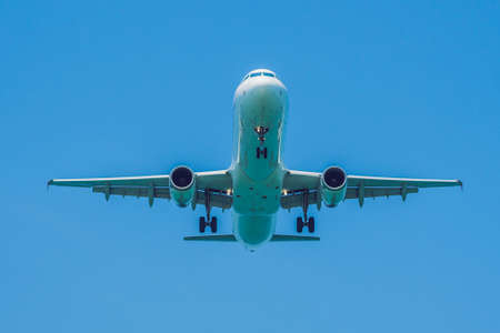 Modern airplane in the sky near Airport. takes off or landing Stock Photo