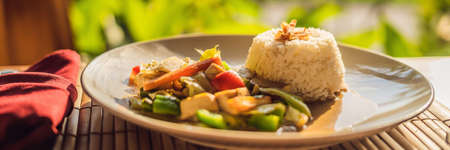 Traditional Balinese cuisine. Vegetable and tofu stir-fry with rice BANNER, long format