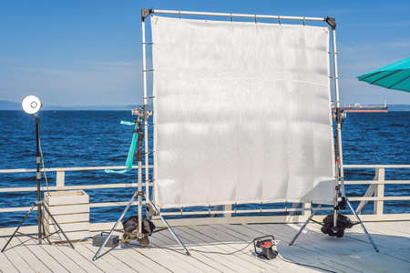 A big frame of a silk textile used for softening of the hard light on a cinema production set.