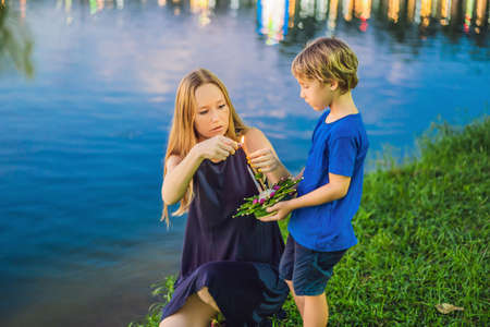 Mom and son tourists celebrates Loy Krathong, Runs on the water. Stock Photo