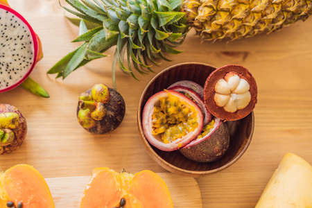 Healthy eating background of different fruits on old wooden table