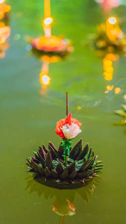 Loy Krathong festival, People buy flowers and candle to light and float on water to celebrate the Loy Krathong festival in Thailand VERTICAL FORMAT Stock Photo