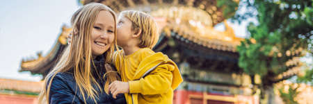 Enjoying vacation in China. Mom and son in Forbidden City. Travel to China with kids concept. Visa free transit 72 hours, 144 hours in China BANNER, LONG FORMAT Stock Photo