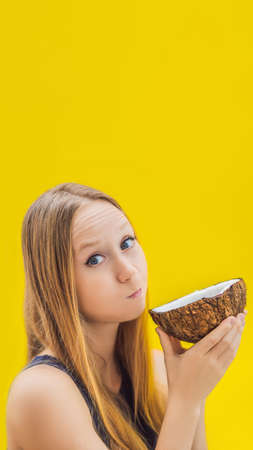 Young woman doing oil pulling over yellow background VERTICAL FORMAT for mobile story or stories size. Mobile wallpaper