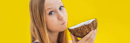 Young woman doing oil pulling over yellow background BANNER, LONG FORMAT