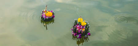 Loy Krathong festival, People buy flowers and candle to light and float on water to celebrate the Loy Krathong festival in Thailand BANNER, LONG FORMAT Stock Photo