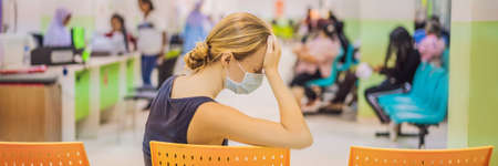 Young woman sitting in hospital waiting for a doctors appointment. Patients In Doctors Waiting Room BANNER, LONG FORMAT