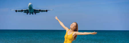 Woman have fun on the beach watching the landing planes. Traveling on an airplane concept. Text space. Island Phuket in Thailand. Impressive paradise. Hot beach Mai Khao. Amazing landscape BANNER, LONG FORMAT