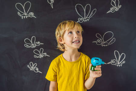 The boy is bitten by mosquitoes holding a fumigator on a dark background. On the blackboard with chalk painted mosquitoes