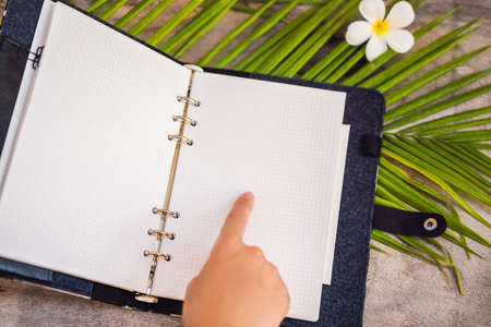 Notepad and stationery on wooden background. Planner for business and study. Fans of stationery