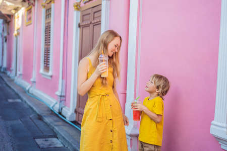 Mom and son tourists on the Street in the Portugese style Romani in Phuket Town. Also called Chinatown or the old town. Traveling with kids concept Banque d'images