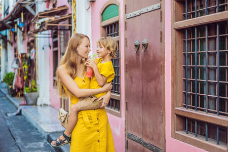 Mom and son tourists on the Street in the Portugese style Romani in Phuket Town. Also called Chinatown or the old town. Traveling with kids concept Stok Fotoğraf