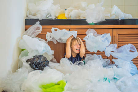 The boys parents used too many plastic bags that they filled up the entire kitchen. Banco de Imagens - 124139763