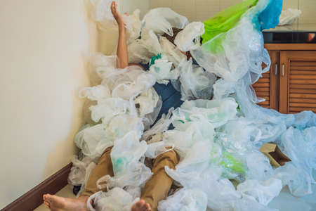 The man used too many plastic bags that they filled up the entire kitchen. Banco de Imagens - 124139702