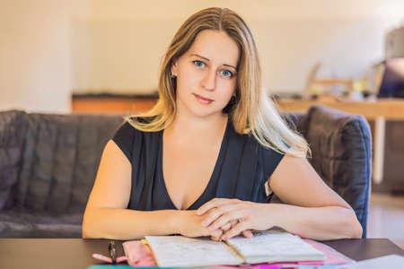 Teacher, tutor for homeschooling at the table Stock Photo