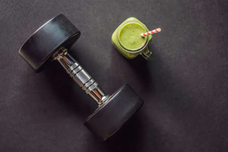Green smoothies and dumbbells in the gym 写真素材