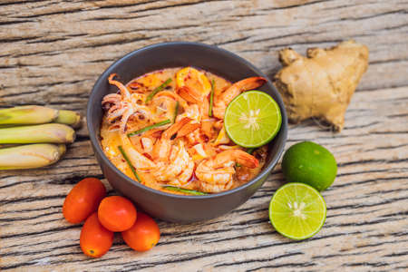 Prawn and lemon grass soup with mushrooms,Tom Yam Kung ,thai food in wooden background, top view Stok Fotoğraf