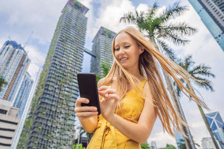 Woman Tourist using navigation app on the mobile phone. Navigation map on a smartphone in a big city