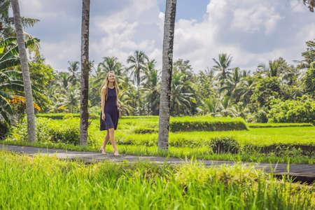 Woman walking in the rice field Bali