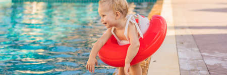 Little boy with inflatable circle at pool BANNER, LONG FORMAT
