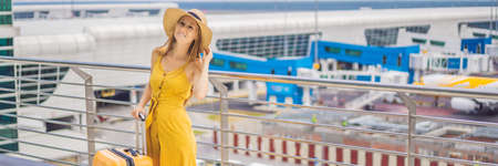 Start of her journey. Beautiful young woman ltraveler in a yellow dress and a yellow suitcase is waiting for her flight BANNER, LONG FORMAT