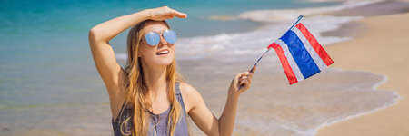 Happy woman having fun at the beach with Thailand flag. Beautiful girl enjoying travel to Asia BANNER, LONG FORMAT