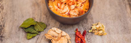 Prawn and lemon grass soup with mushrooms,Tom Yam Kung ,thai food in wooden background, top view BANNER, LONG FORMAT