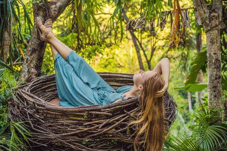 Bali trend, straw nests everywhere. Young tourist enjoying her travel around Bali island, Indonesia.