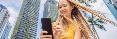 Woman Tourist using navigation app on the mobile phone.