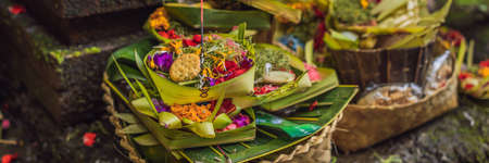 Daily offerings - canang sari is very important in Bali, Indonesia Banco de Imagens - 129827997